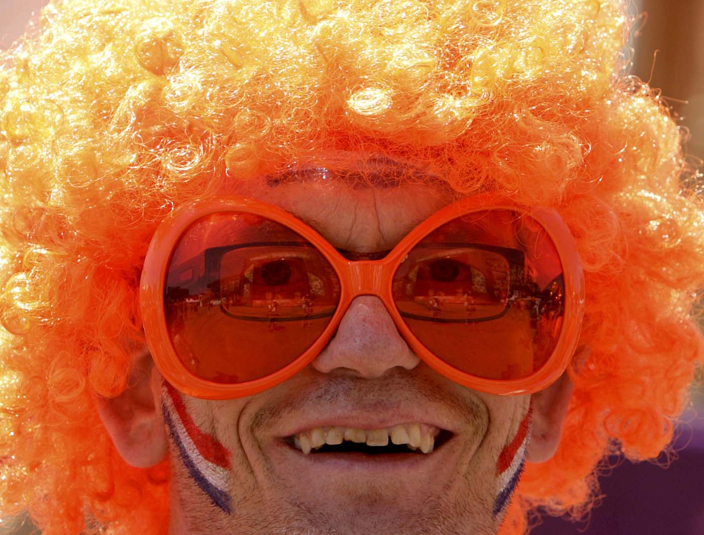 A Dutch soccer fan smiles as he relaxes at the Euro 2012 fan zone in Kharkiv, some 480 km (300 miles) east of Kiev, June 13, 2012. (Vasily Fedosenko/Reuters)