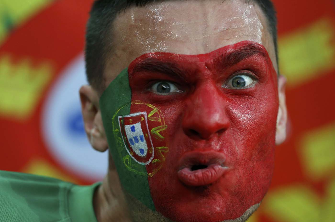 A Portugal's fan gestures as he waits for the start of their Group B Euro 2012 soccer match against Netherlands at the Metalist stadium in Kharkiv June 17, 2012. (Alessandro Bianchi/Reuters)