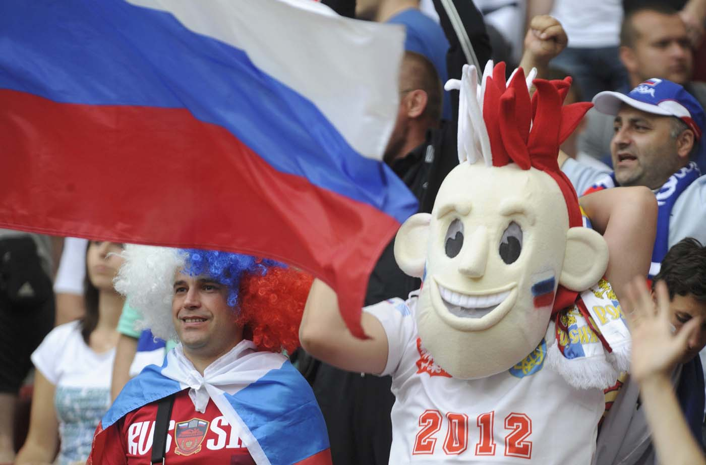 Russia's soccer fans cheer before the Group A Euro 2012 soccer match against Poland at national stadium in Warsaw June 12, 2012. (Pawel Ulatowski/Reuters)