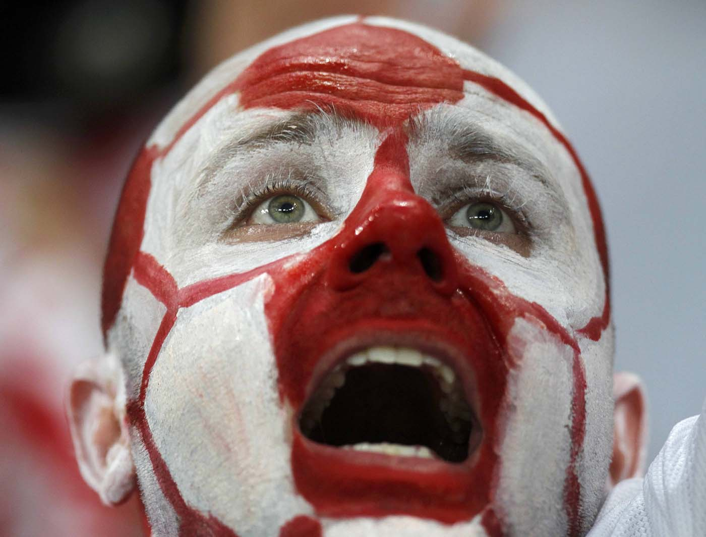A fan of Poland with his face painted in the Polish colours cheers before the start of their Group A Euro 2012 soccer match against Czech Republic at the City Stadium in Wroclaw, June 16, 2012. (Kacper Pempel/Reuters)