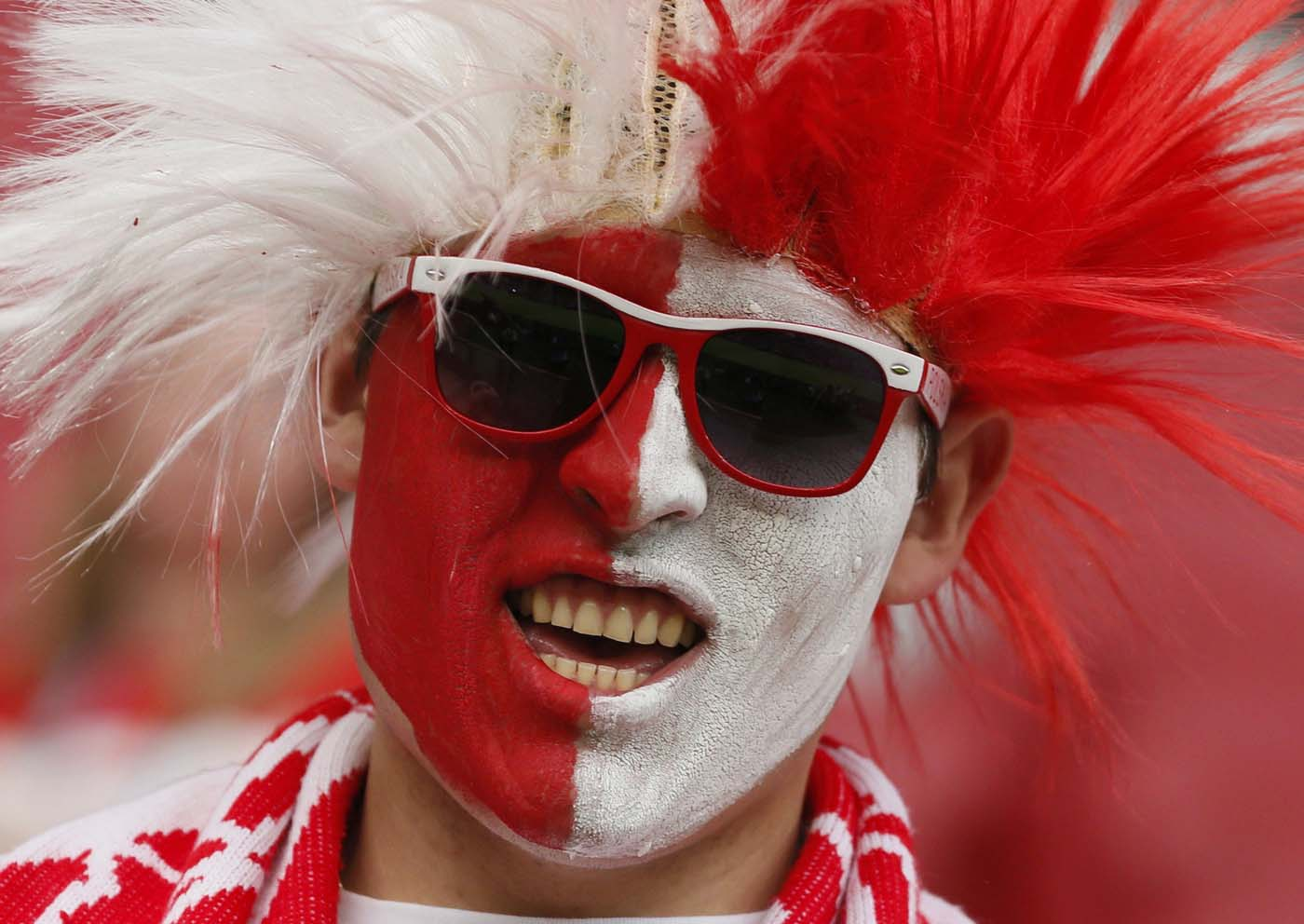 A Poland soccer fan waits for the start of the Group A Euro 2012 soccer match between Poland and Russia at the National stadium in Warsaw June 12, 2012. (Pascal Lauener/Reuters)
