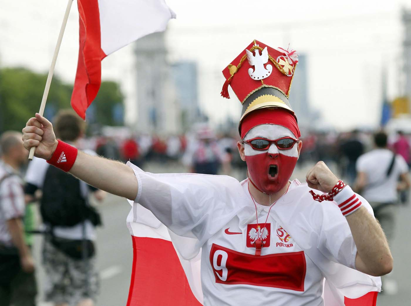A Polish soccer fan shouts on his way to the National Stadium in Warsaw, June 12, 2012. Russia on Tuesday will play Poland in their Euro 2012 Group A soccer tournament in Warsaw. (Jerzy Dudek/Reuters)