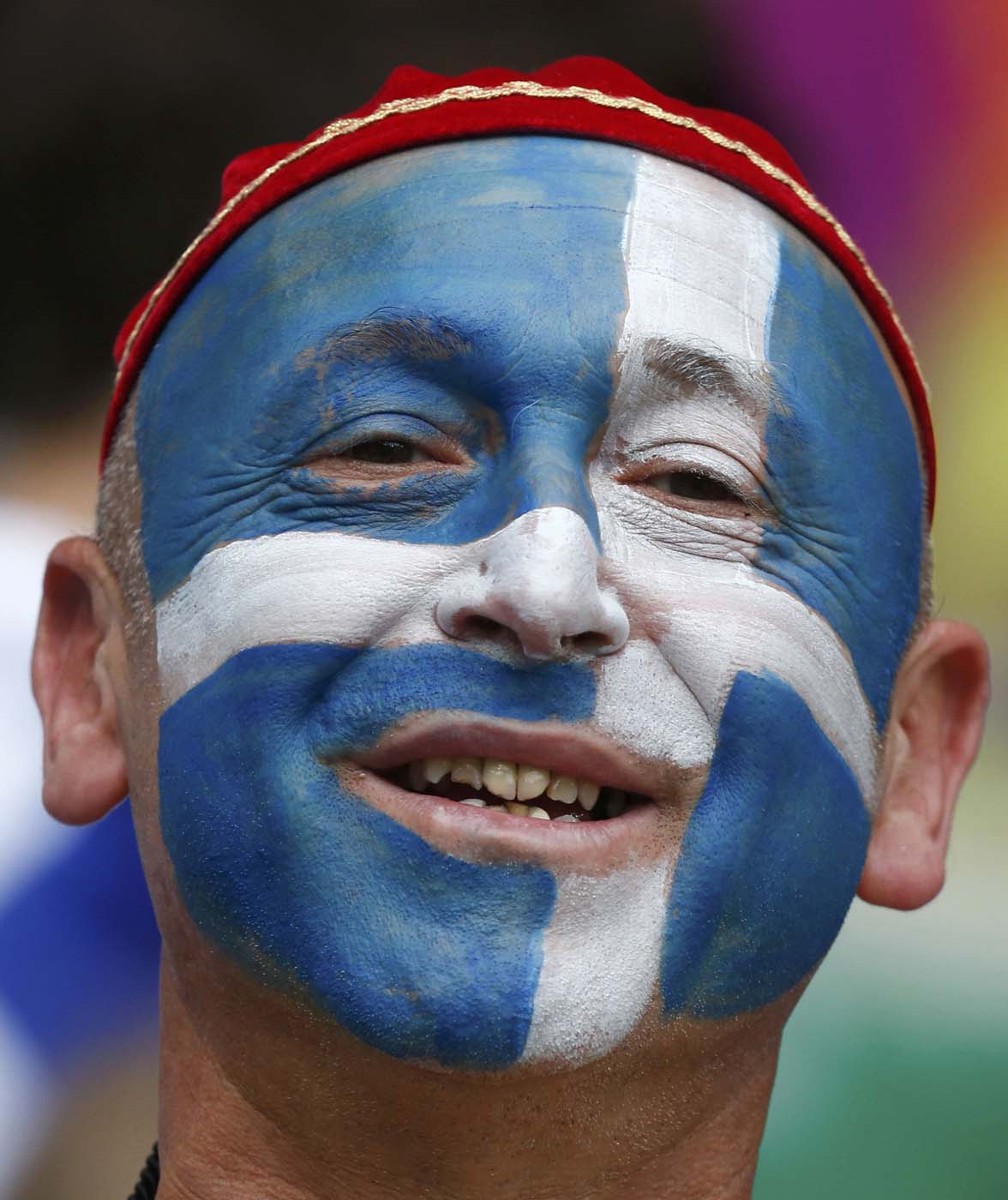 A Greece soccer fan with his face painted smiles as he waits for the start of the Group A Euro 2012 soccer match against Czech Republic at the city stadium in Wroclaw, June 12, 2012. (Dominic Ebenbichler/Reuters)