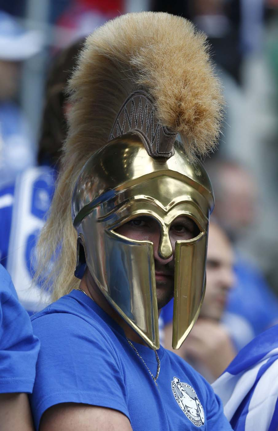 A Greece soccer fan wearing a Spartan helmet waits for the start of the Group A Euro 2012 soccer match against Czech Republic at the city stadium in Wroclaw, June 12, 2012. (Dominic Ebenbichler/Reuters)