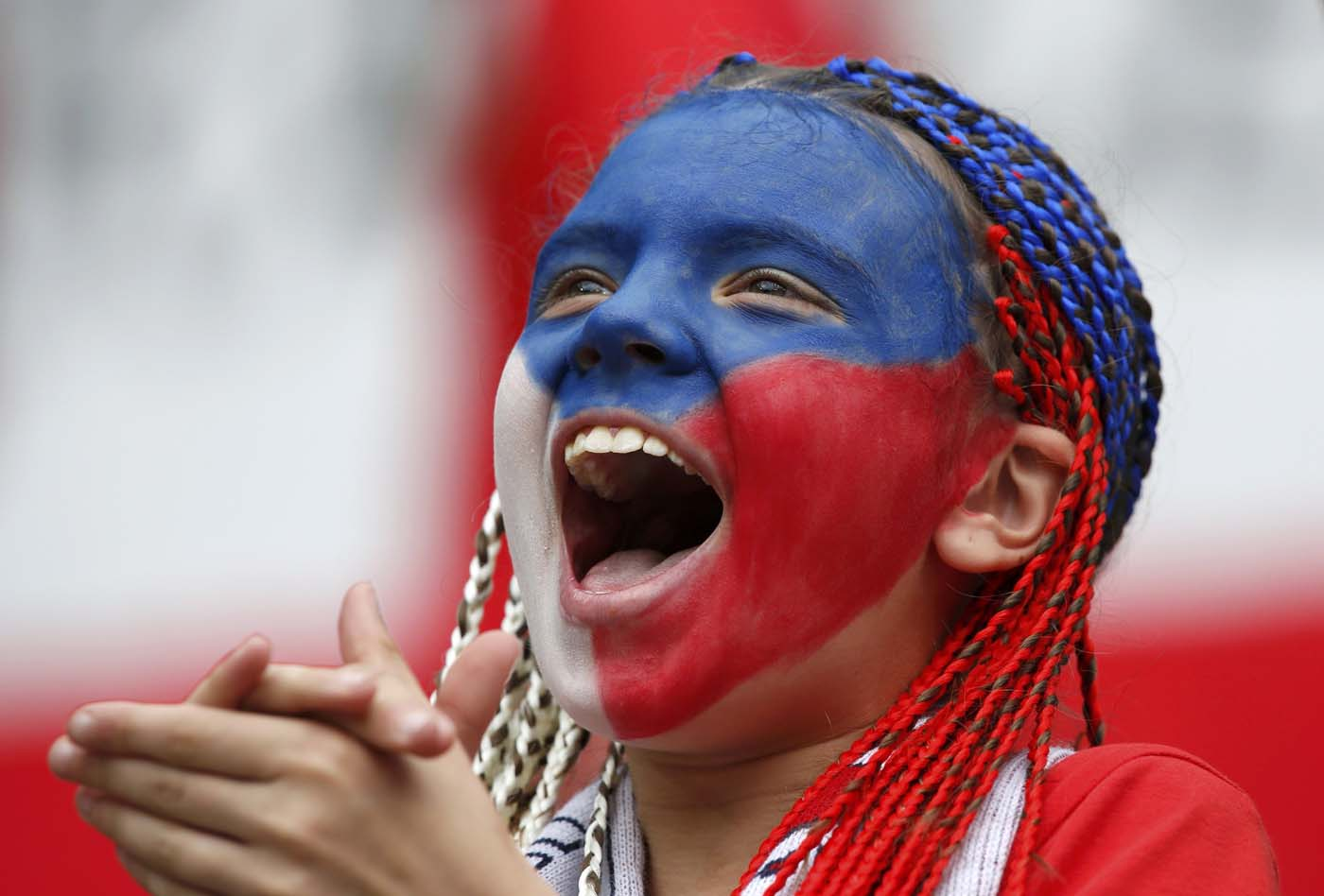 Czech Republic's soccer team fan with her face painted cheers before the start of the Group A Euro 2012 soccer match against Greece at the City stadium in Wroclaw June 12, 2012. (Sergio Perez/Reuters)