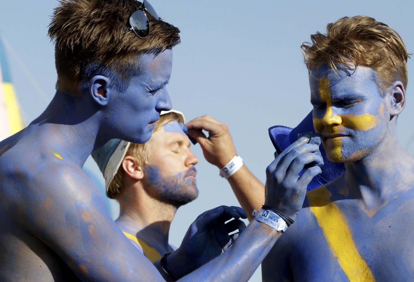 Sweden soccer fans paint each others faces before marching to the Olympic stadium in Kiev June 11, 2012. Sweden will play its first match of the Euro 2012 soccer championships against Ukraine in Kiev on Monday. (Anatolii Stepanov/Reuters)