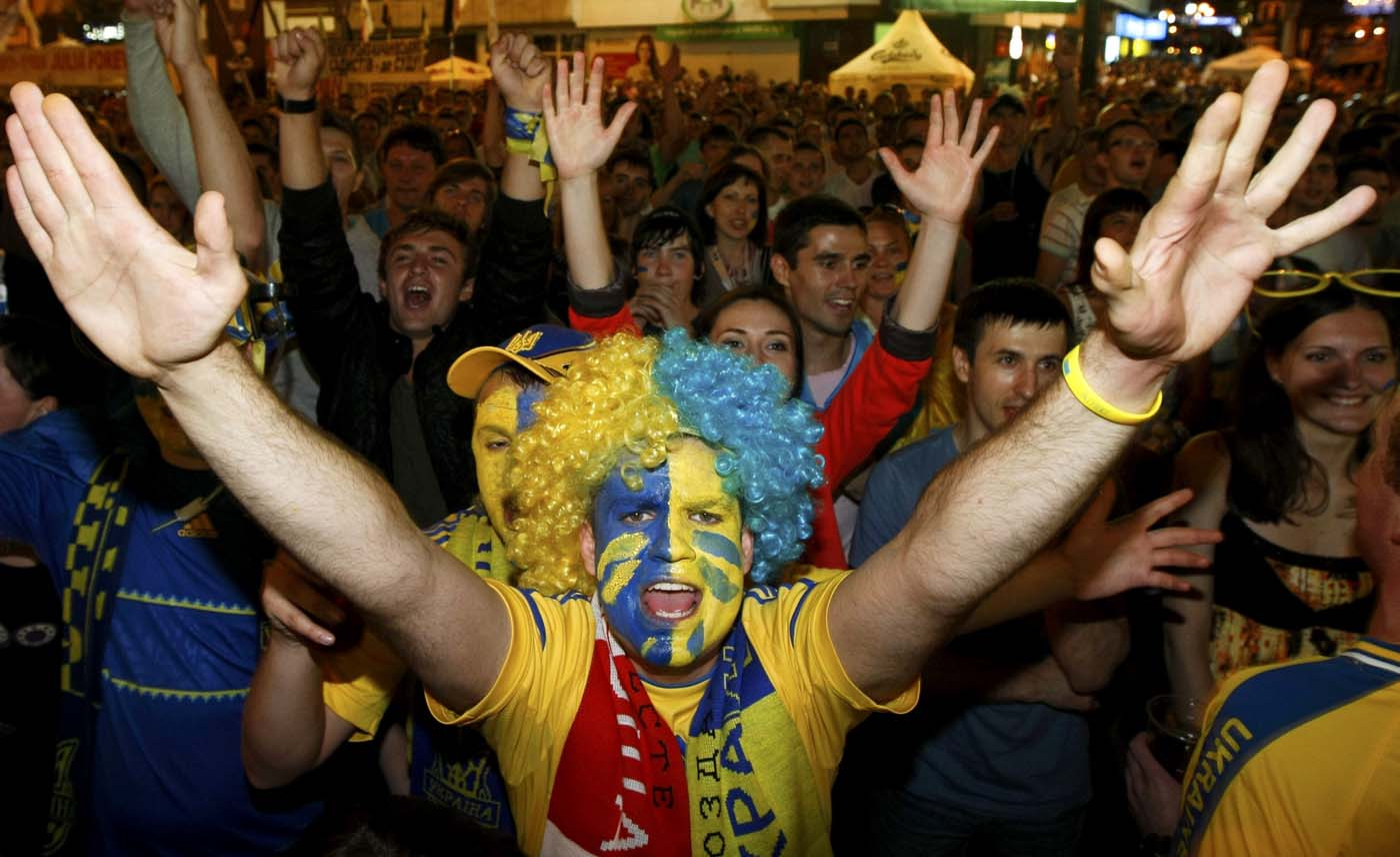 Ukrainian soccer fans react as they watch Euro 2012 soccer match between Sweden and Ukraine in the fan zone in Kiev, June 11, 2012. (Anatolii Stepanov/Reuters)