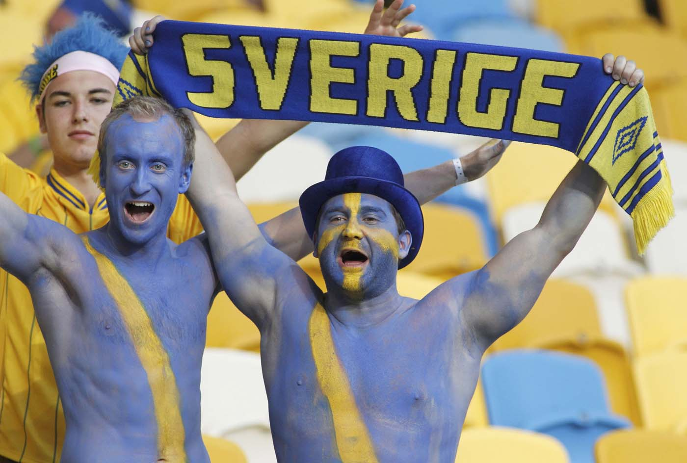 Sweden's soccer fans with painted bodies cheer before their Group D Euro 2012 soccer match against Ukraine at the Olympic stadium in Kiev, June 11, 2012. (Gleb Garanich/Reuters)