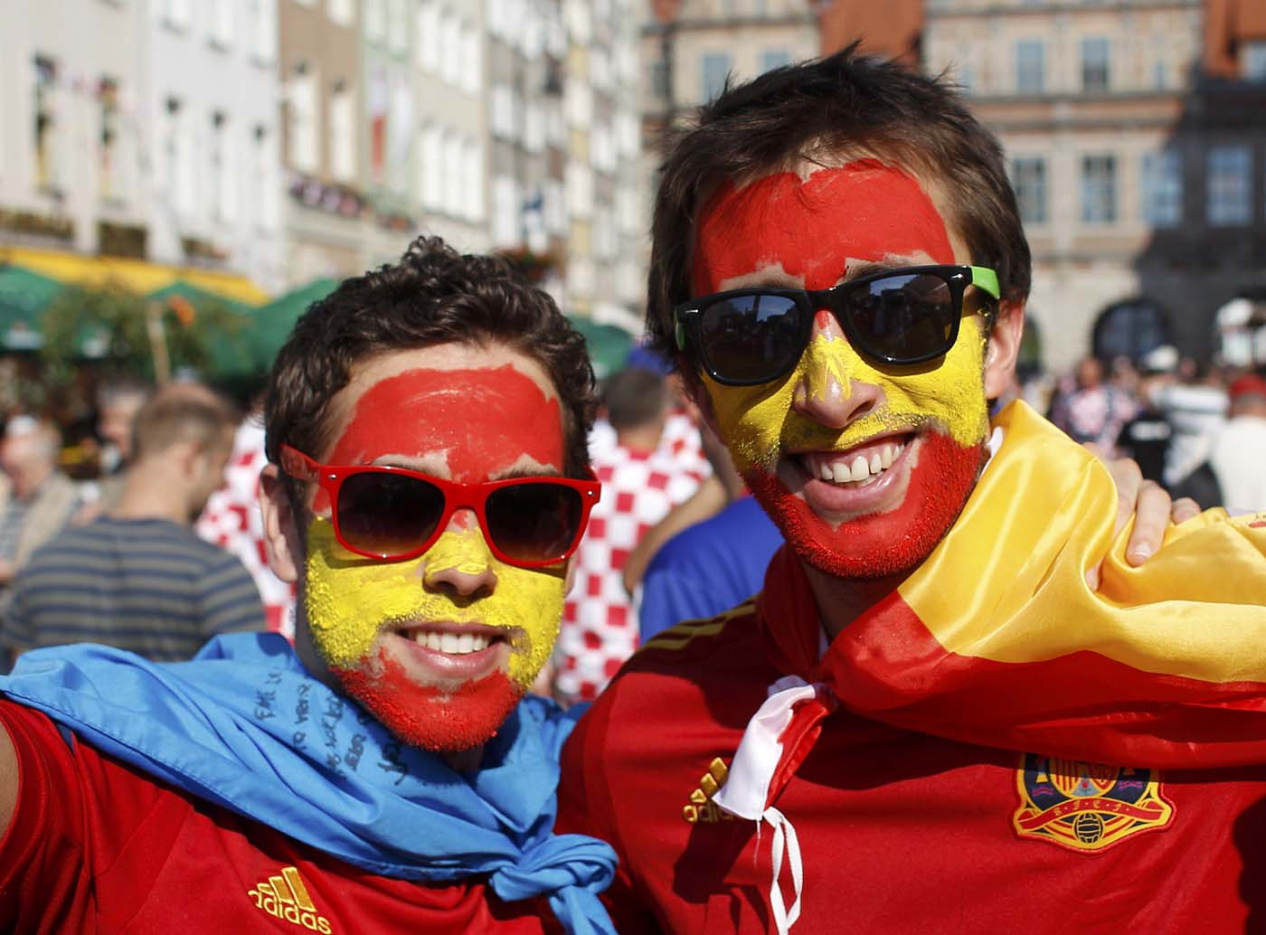Spanish fans cheer before Euro 2012 soccer match against Croatia in the Old Town of Gdansk June 18, 2012. (Peter Andrews/Reuters)