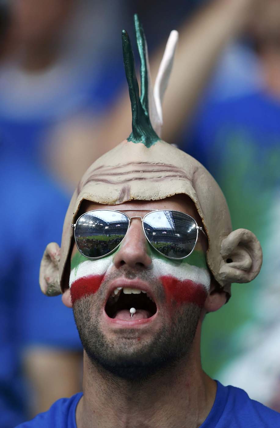 An Italy's fan cheers before their Group C Euro 2012 soccer match against Ireland at the Ctiy stadium in Poznan June 18, 2012. (Sergio Perez/Reuters)