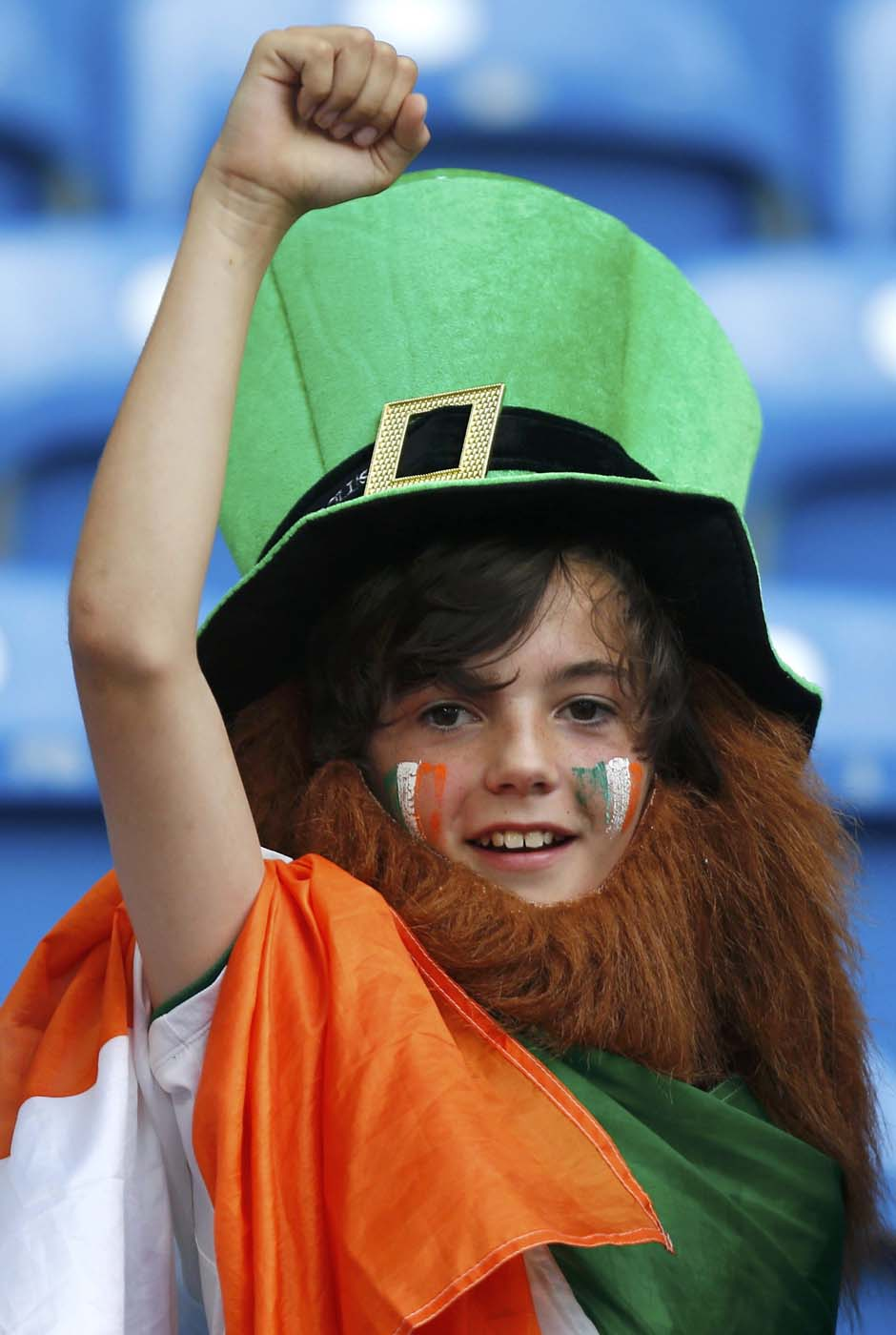 A young Irish soccer fan cheers before the Group C Euro 2012 soccer match between Italy and Ireland at the city stadium in Poznan June 18, 2012. (Dominic Ebenbichler/Reuters)