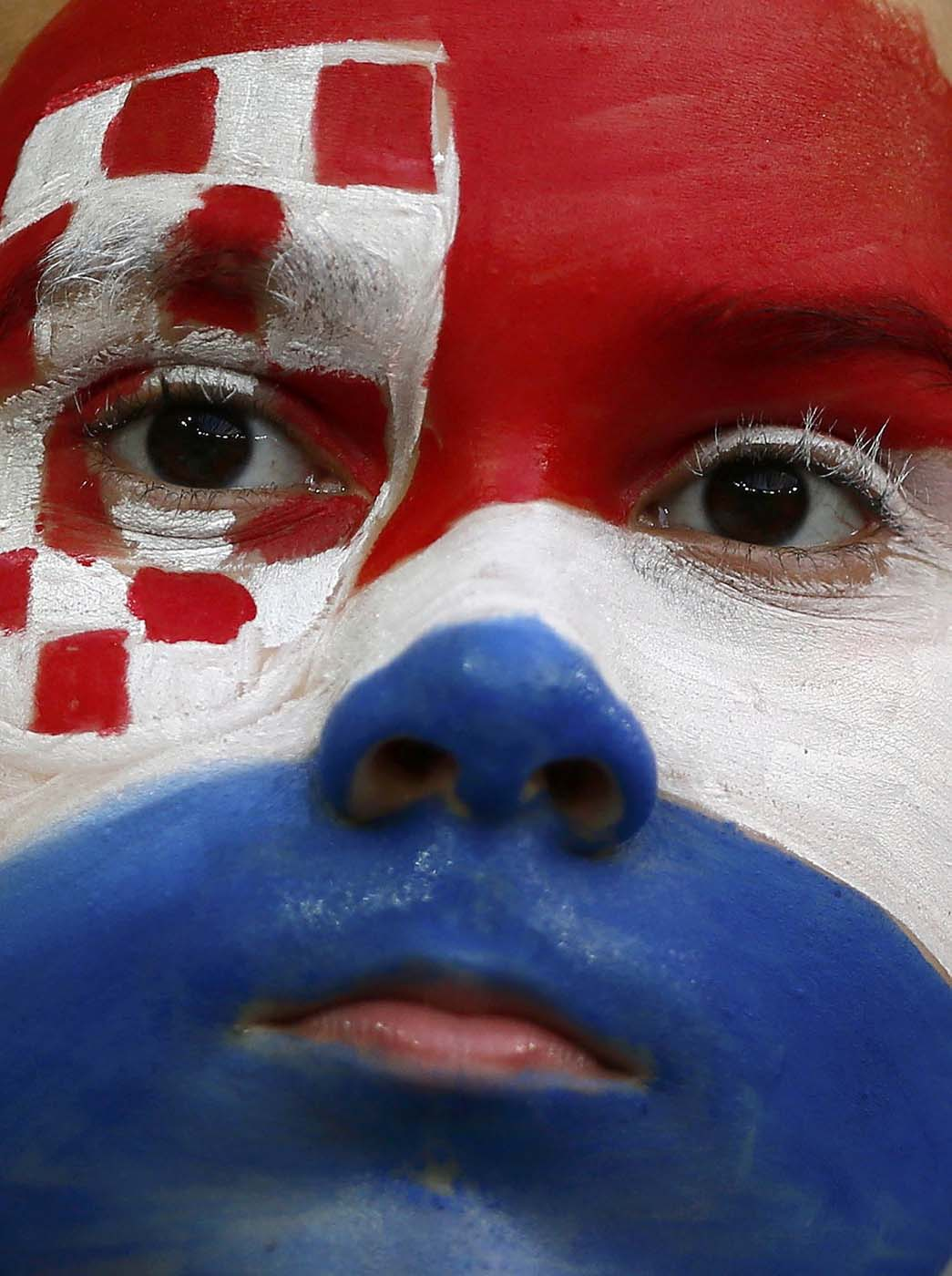 A fan of Croatia with his face painted in national flag colours is pictured before their Group C Euro 2012 soccer match against Spain at the PGE Arena in Gdansk June 18, 2012. (Kai Pfaffenbach/Reuters)