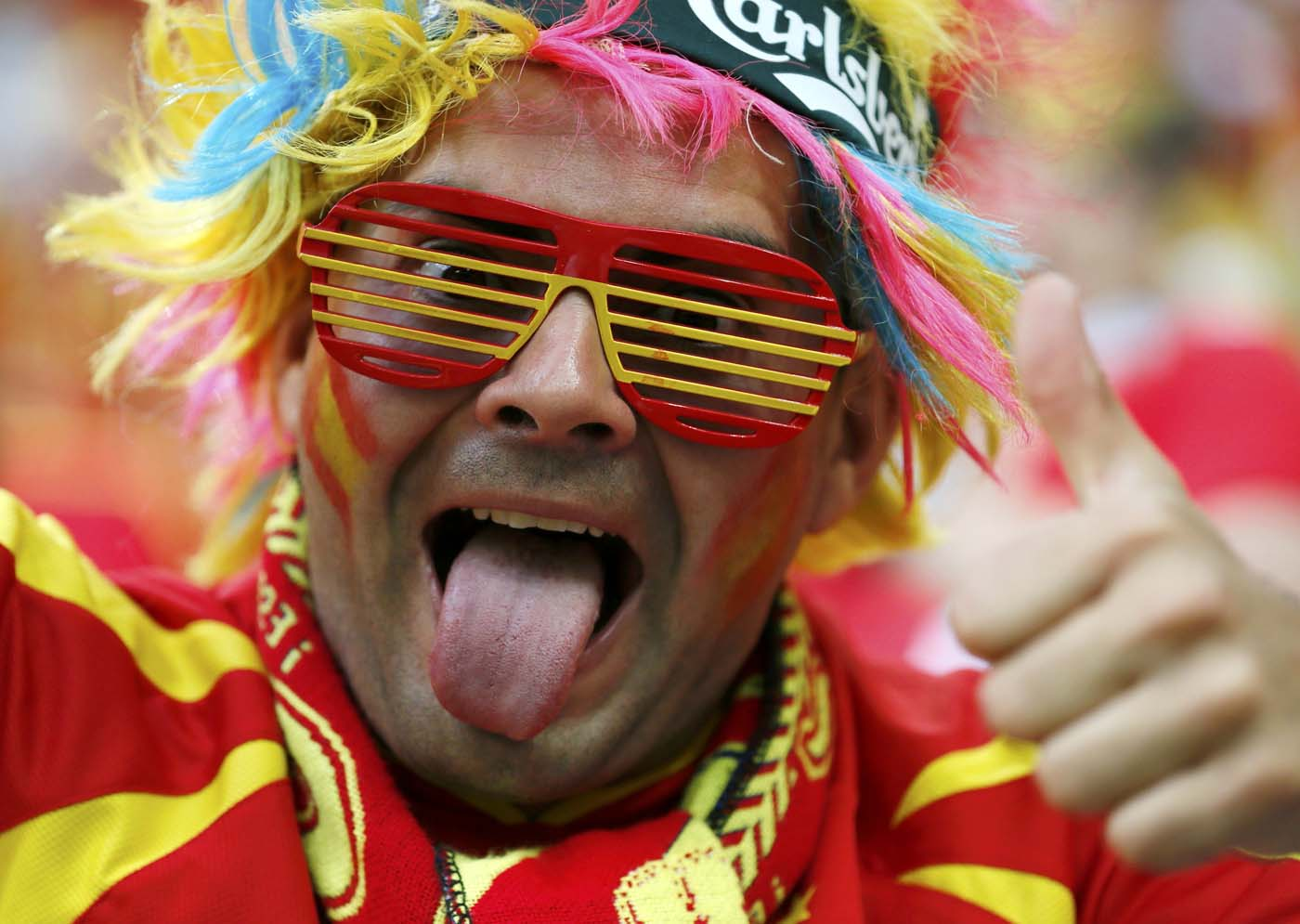 A Spain's soccer fan with sunglasses in colors of the national flag cheers as he waits for the start of the Group C Euro 2012 soccer match against Croatia at the PGE Arena in Gdansk, June 18, 2012. (Pascal Lauener/Reuters)
