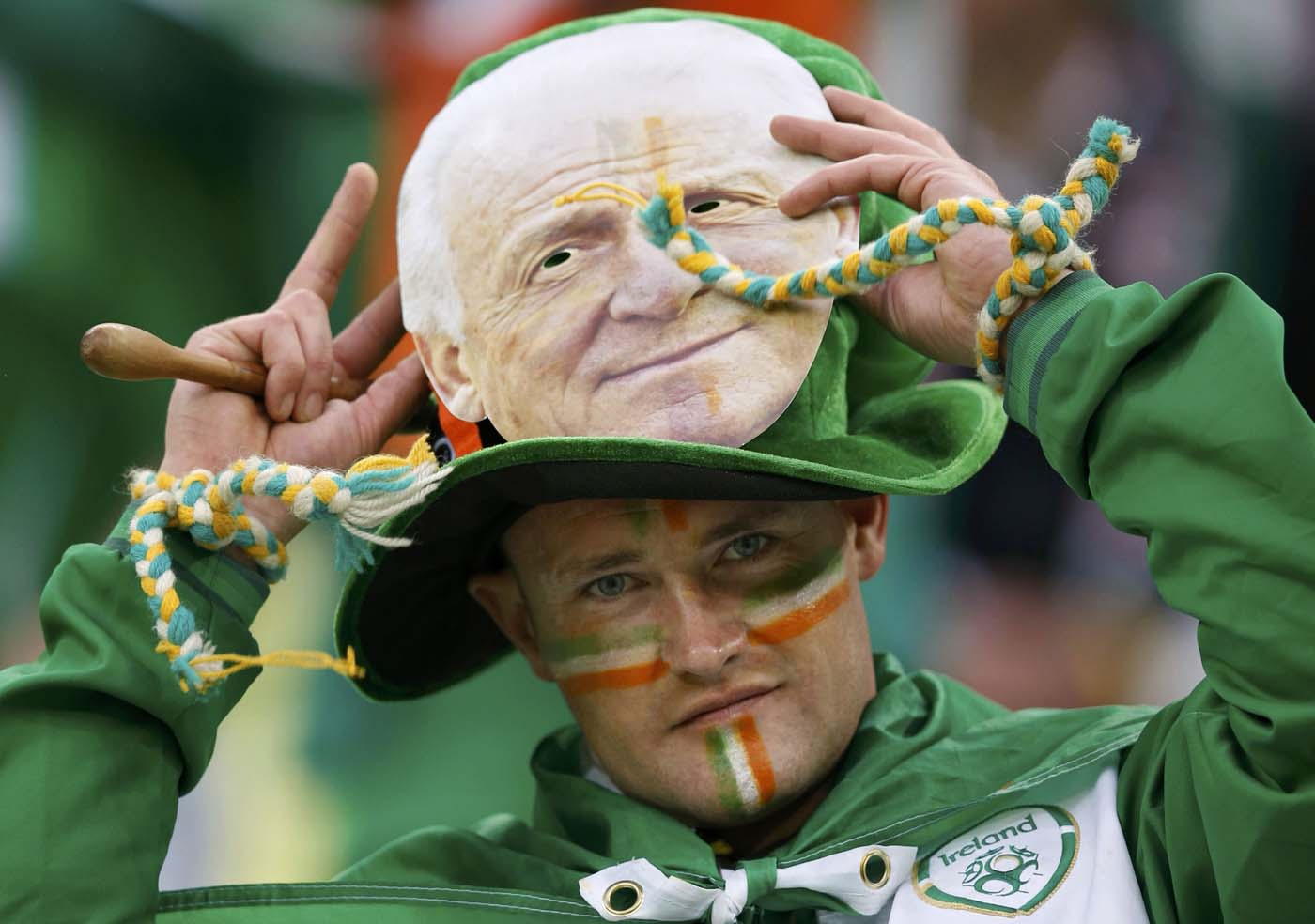 An Ireland's fan with a mask of Ireland's coach Giovanni Trapattoni waits for the start of their Group C Euro 2012 soccer match against Spain at the PGE Arena stadium in Gdansk, June 14, 2012. (Thomas Bohlen/Reuters)