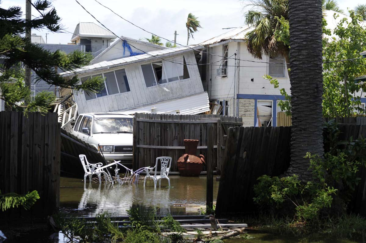 Structural damage is seen on a street in Pass-A-Grille Beach, damaged on Sunday night by what residents describe as a tornado, as high winds and storm surge associated with Tropical Storm Debby continue to affect the area in Florida. (Brian Blanco/Reuters Photo)