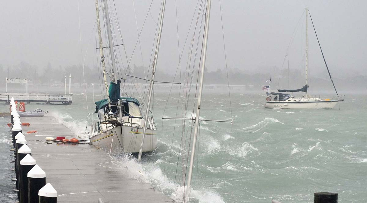 Boats slam against a pier after breaking free from their moorings as a storm surge and high winds from Tropical Storm Debby batter Bradenton Beach, Florida. The National Hurricane Center expects Debby to make landfall on Thursday in the Florida Panhandle as a tropical storm, but warns that forecasts remain uncertain. (Brian Blanco/Reuters photo)
