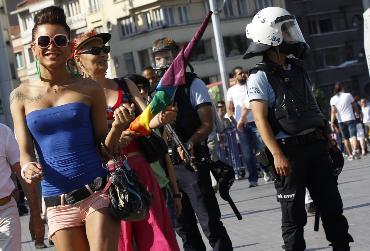 Istanbul: Participants walk past riot police during a gay pride parade June 24, 2012. (Murad Sezer/Reuters)