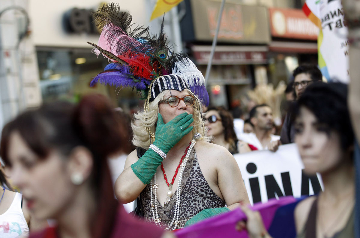 Istanbul: A participant blows a kiss during a gay pride parade June 24, 2012. (Murad Sezer/Reuters)
