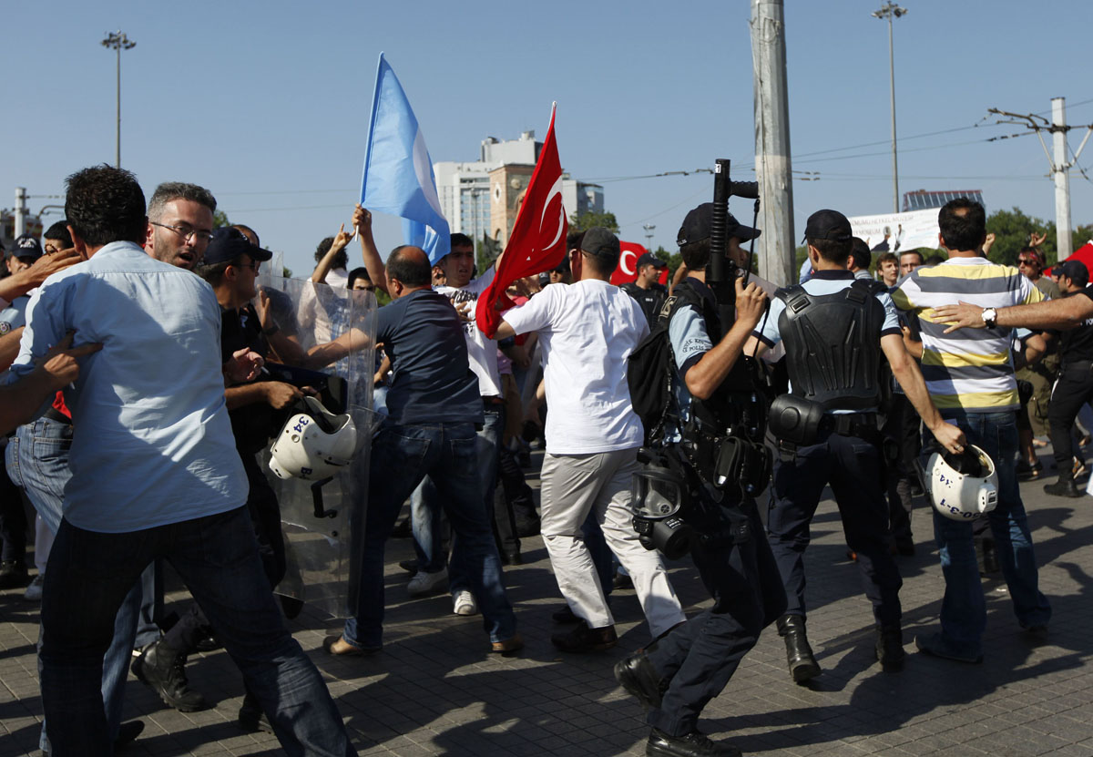 Istanbul: Riot police prevent nationalist demonstrators from obstructing a gay pride parade June 24, 2012. (Murad Sezer/Reuters)