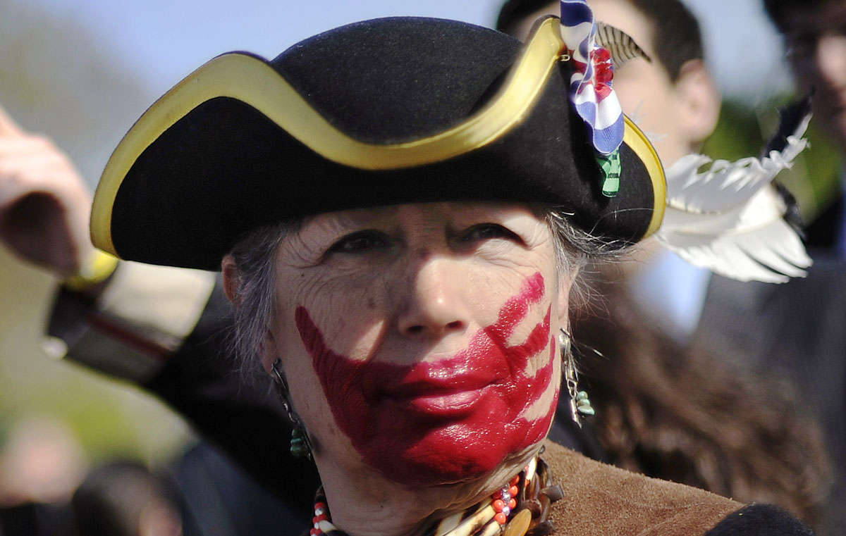 March 28, 2012: Tea party supporter Susan Clark of California, dressed in colonial garb and face paint, protests against the Obama healthcare legislation as the law's supporters and detractors rally on the sidewalk in front of the Supreme Court, during the third and final day of legal arguments over the Patient Protection and Affordable Care Act in Washington March 28, 2012. Two years after President Barack Obama signed into law the healthcare overhaul, the Supreme Court is taking up a historic test of whether it is valid under the country's Constitution. (Jonathan Ernst/Reuters)