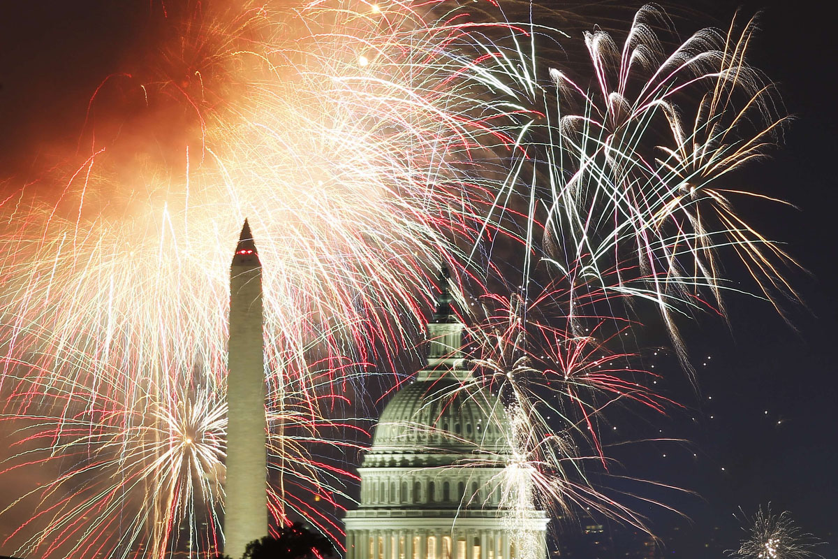 Fireworks light up the sky over the United States Capitol dome and the Washington Monument as the U.S. celebrates its 235th Independence Day in Washington on July 4, 2011. (Hyungwon Kang/Reuters)