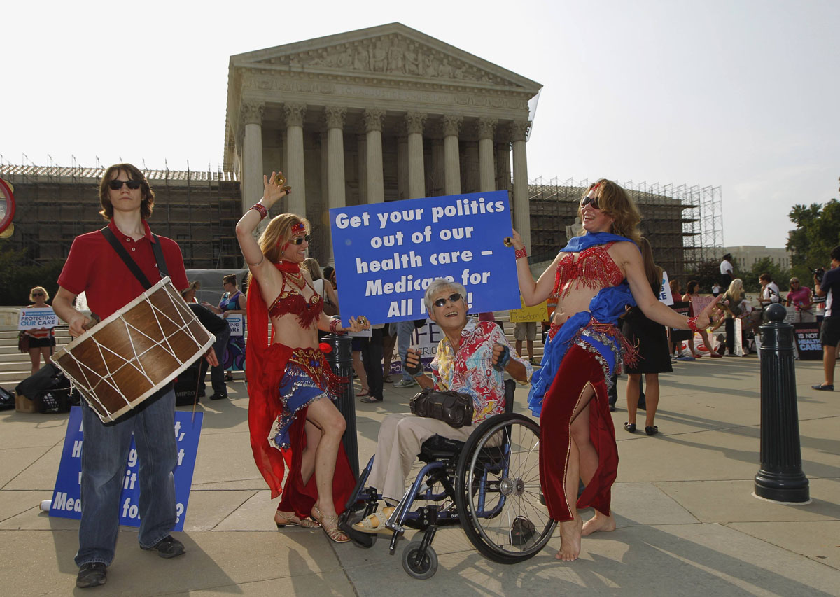 June 28, 2012: Belly dancers calling for single payer national health insurance perform outside the Supreme Court in Washington, June 28, 2012. The Supreme Court is set to deliver on Thursday its ruling on President Barack Obama's 2010 healthcare overhaul, his signature domestic policy achievement, in a historic case that could hand him a huge triumph or a stinging rebuke just over four months before he seeks re-election. (Jason Reed/Reuters)