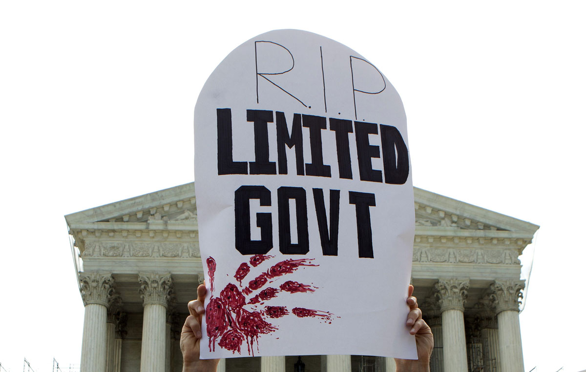 June 28, 2012: A detractor of the Affordable Healthcare Act holds a sign in front of the Supreme Court after the court upheld the legality of the law in Washington June 28, 2012. A sharply divided U.S. Supreme Court on Thursday upheld the centerpiece of President Barack Obama's signature healthcare overhaul law that requires that most Americans get insurance by 2014 or pay a financial penalty. (Jason Reed/Reuters)
