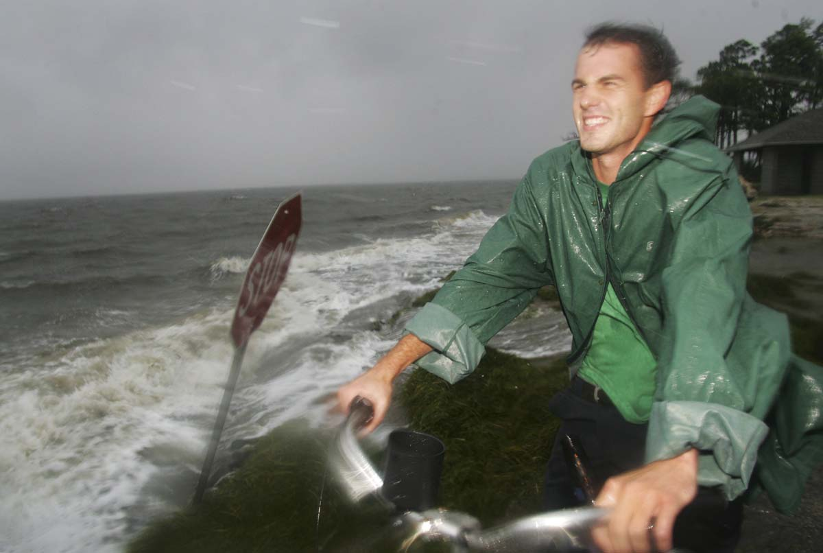 Patrick Baroody reacts to the rain squalls at the end of Mashes Sands Road in Panacea. Tropical Storm Debby dumped heavy rain over parts of Florida on Monday as it idled in the northern Gulf of Mexico, threatening to bring flooding and tornadoes.(Phil Sears/Reuters photo)