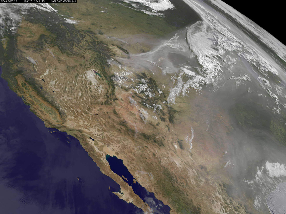 JUNE 28: Smoke and haze over the Midwest, arising from forest fires throughout the Rockies, are pictured in this June 28, 2012 handout NASA satellite image. While the most publicized fires occur along the eastern range in Colorado, the great smoke plumes in this image came from Wyoming. (NASA/Handout/Reuters)