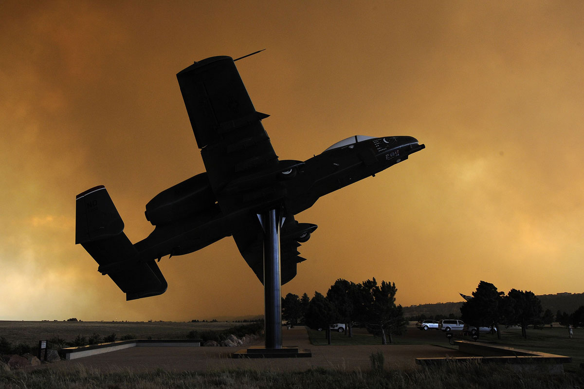 JUNE 26: An A-10 aircraft on static display is silhouetted against a smoke cloud from the Waldo Canyon Fire at the USAF Academy's airfield in Colorado Springs, Colorado in this U.S. Air Force handout photo dated June 26, 2012. The wildfire that forced the evacuation of 35,000 people from the edge of Colorado's second-largest city has killed at least one person and incinerated 346 homes, making it the most destructive blaze in state history, officials said on Thursday. (U.S. Air Force/Mike Kaplan/Handout/Reuters)