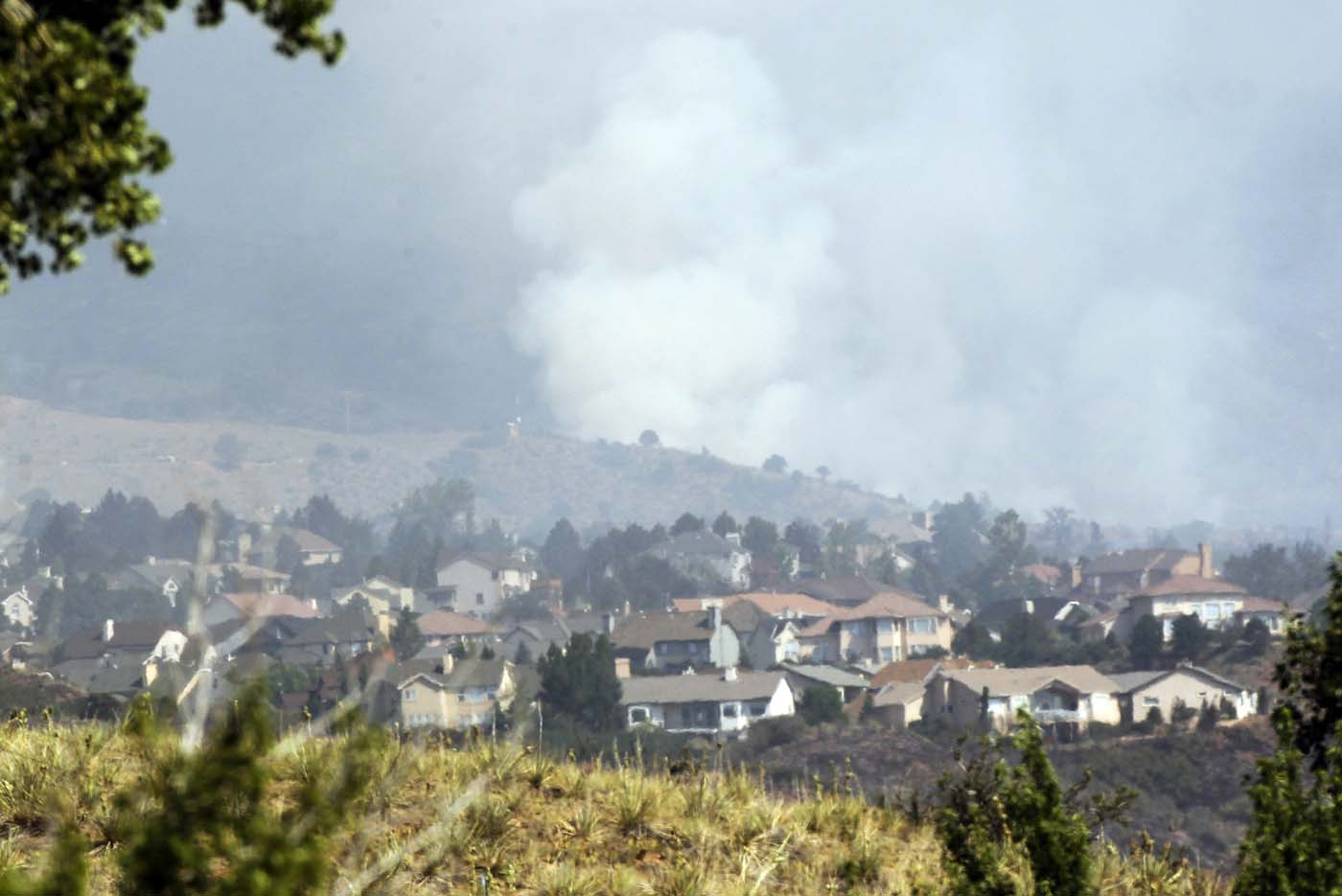 JUNE 27: Smoke rises behind a neighborhood in the Waldo Canyon fire west of Colorado Springs, Colorado June 27, 2012. (Rick Wilking/Reuters)