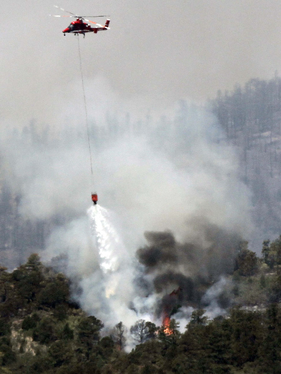 JUNE 25: A helicopter drops water on the Waldo Canyon fire west of Colorado Springs, Colorado June 25, 2012. (Rick Wilking/Reuters)