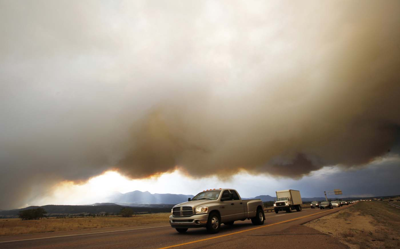 JUNE 26: Smoke from the Waldo Canyon fire hovers over the I-25 north of Colorado Springs in Colorado June 26, 2012. (Rick Wilking/Reuters)