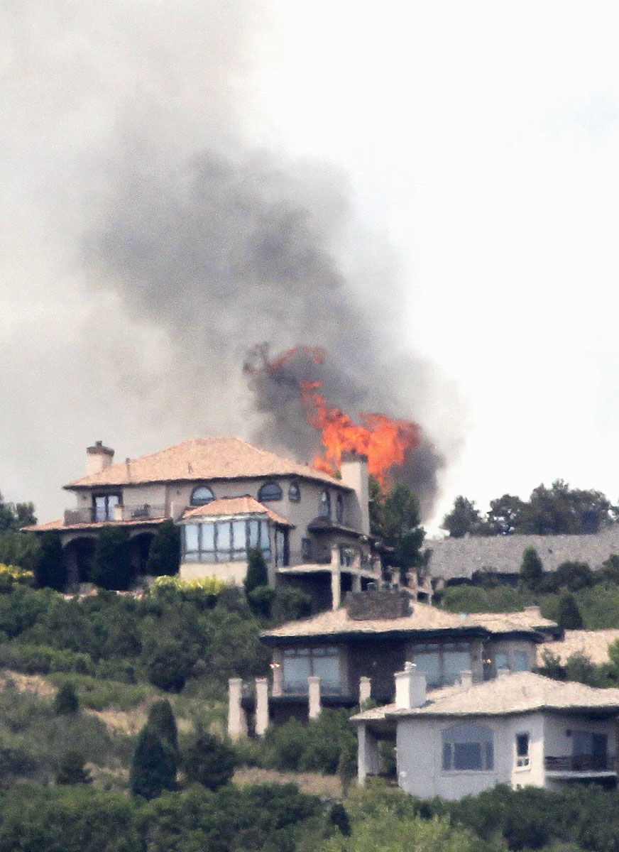 JUNE 24: Flames explode next to house in a mountain subdivision, west of Colorado Springs June 24, 2012. (Rick Wilking/Reuters)