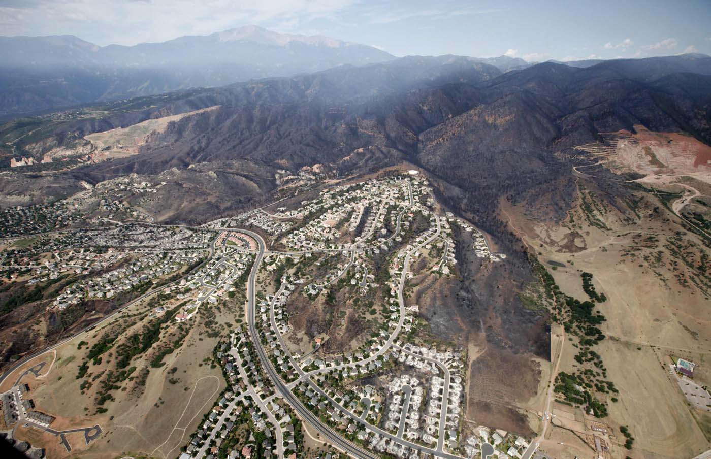 JUNE 28: The burned area of hundreds of totally destroyed homes in the Waldo Canyon fire is seen from the air with Pikes Peak in the background in Colorado Springs, Colorado June 28, 2012. (Rick Wilking/Reuters)