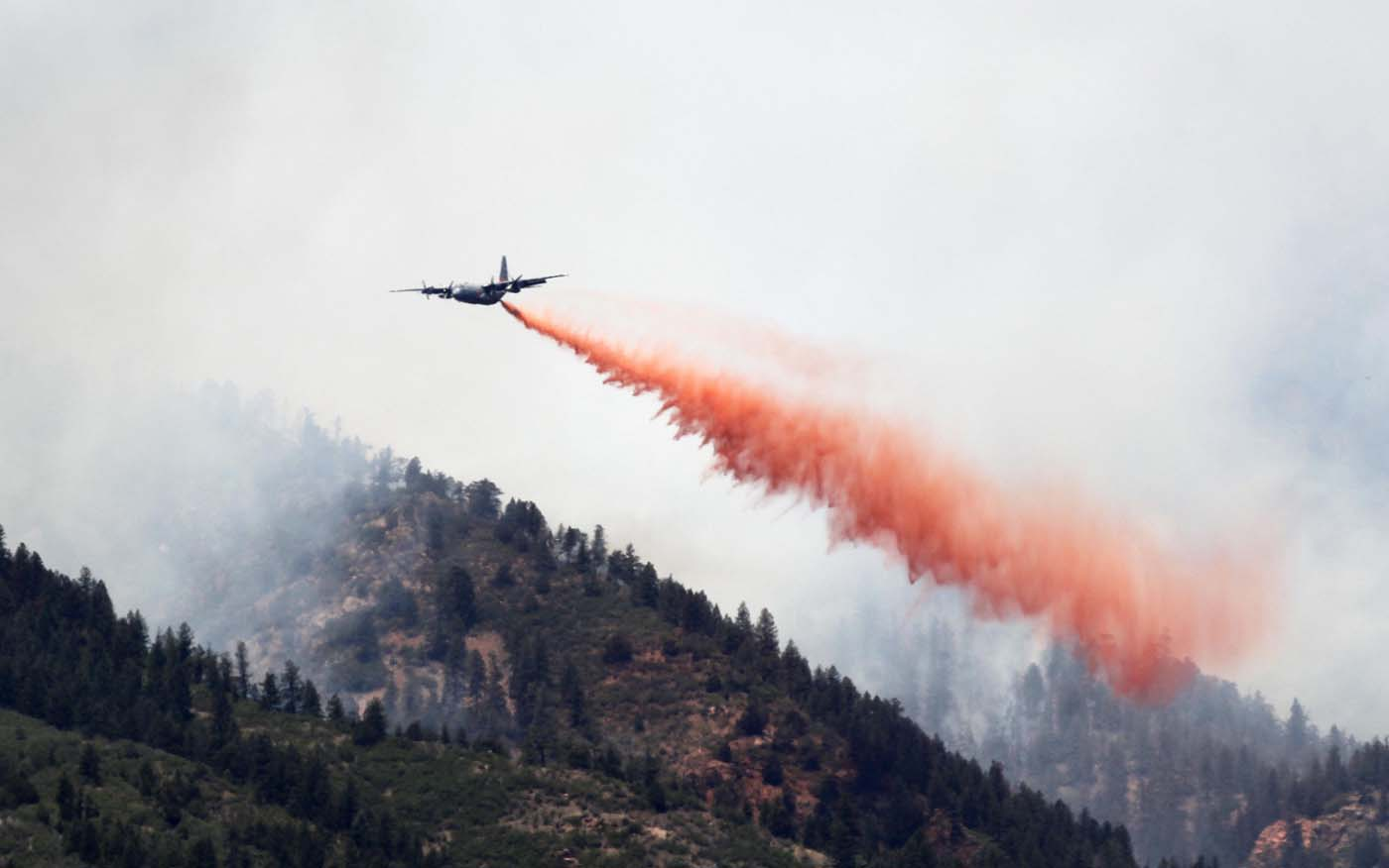 JUNE 26: A C-130 military cargo plane drops thousands of gallons of retardant on the Waldo Canyon fire west of Colorado Springs, Colorado June 26, 2012. (Rick Wilking/Reuters)