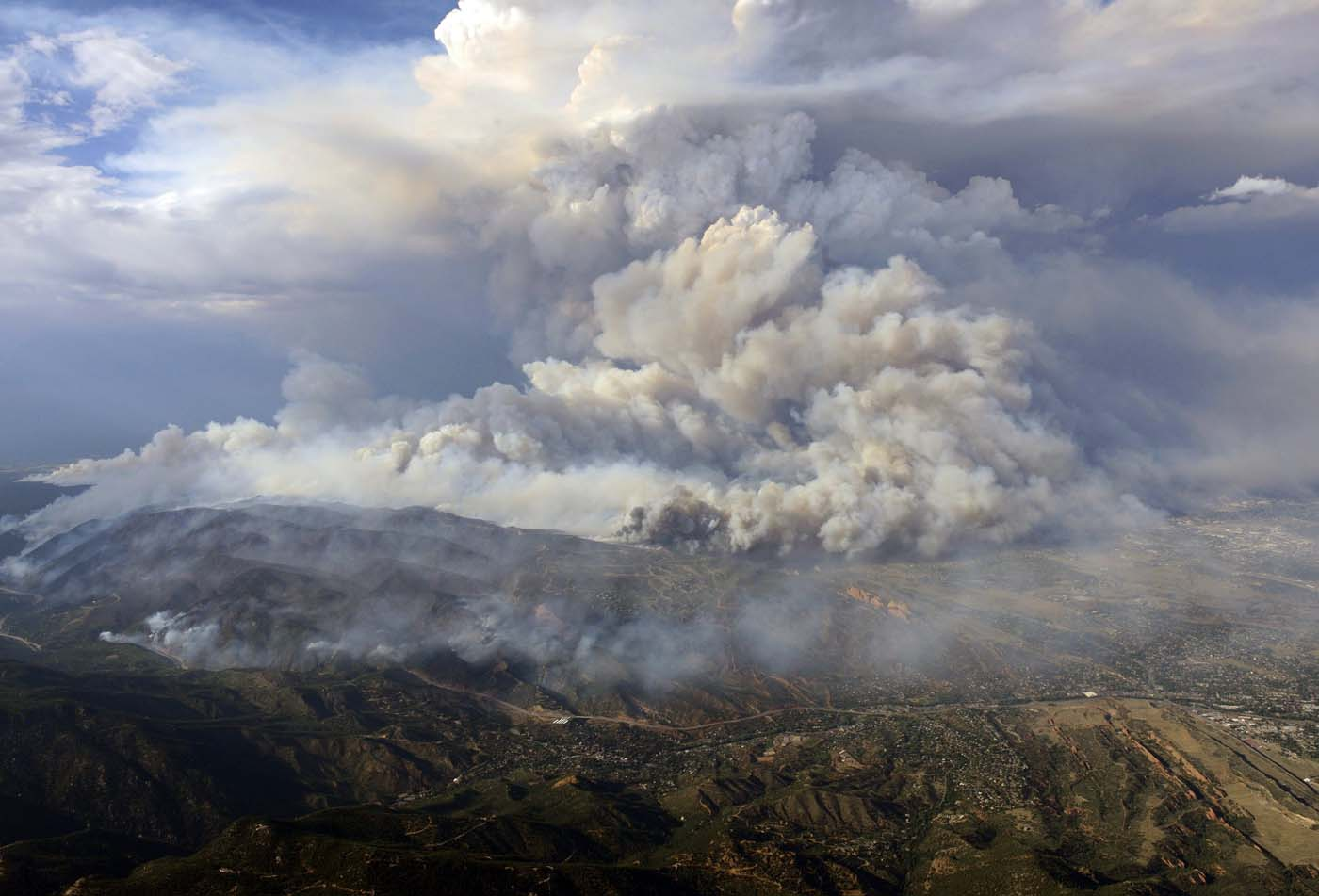 JUNE 26: Plume of smoke rises from Waldo canyon wildfire in this aerial photograph taken in Colorado Springs, Colorado on June 26, 2012. (John Wark/Reuters)