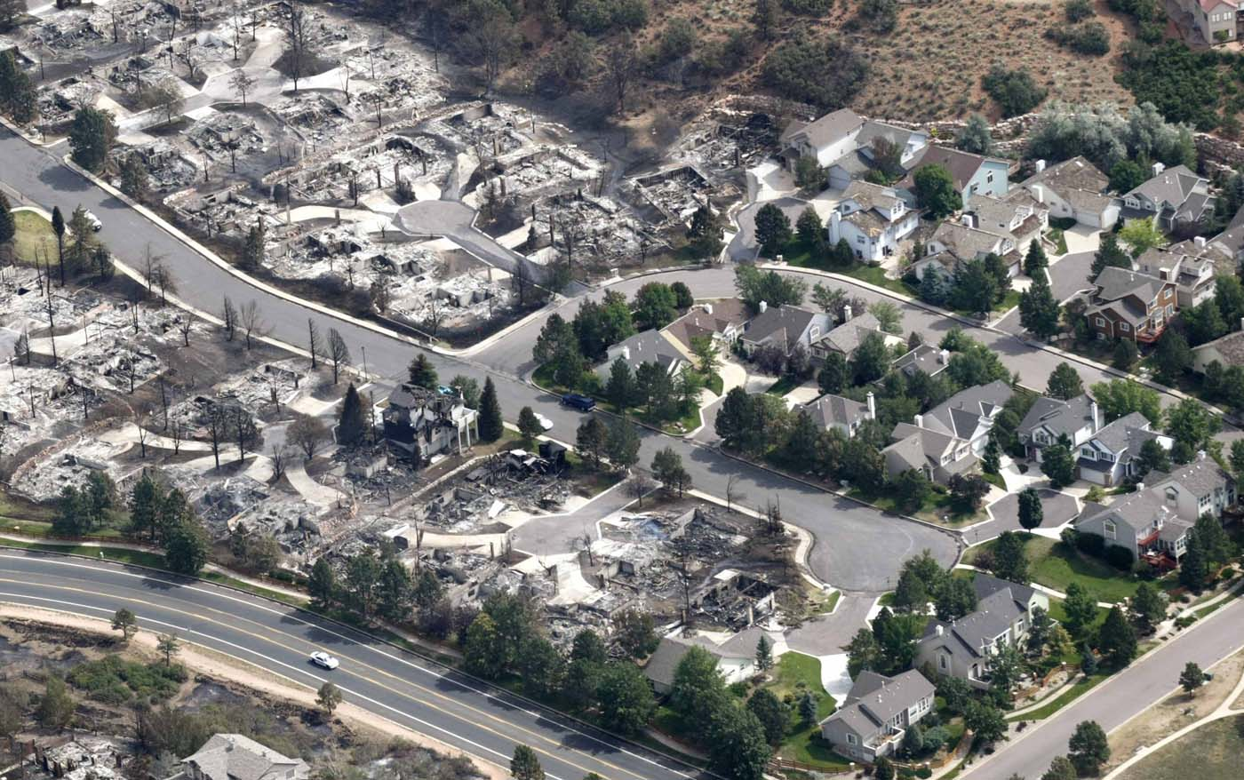 JUNE 28: An aerial photo shows the aftermath of the Waldo Canyon fire at a neighborhood with houses that were and were not destroyed by the fire in Colorado Springs, Colorado June 28, 2012. (Rick Wilking/Reuters)