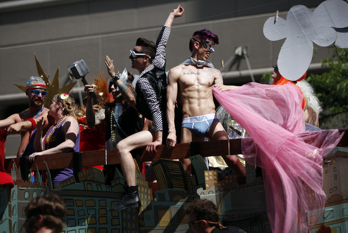 Salt Lake City: Revelers ride in a float during the gay pride parade June 3, 2012. Over 300 active Mormons and more than 5,000 members of the Lesbian, Gay, Bisexual and Transgender (LGBT) community with their supporters marched in the parade as part of the Utah Pride Festival. (Jim Urquhart/Reuters)