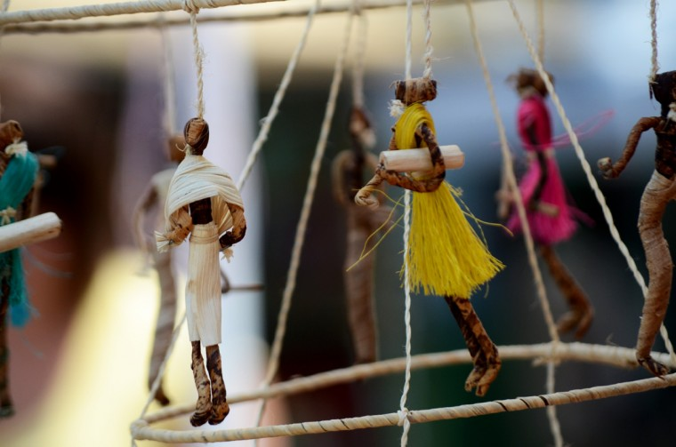 Small, woven dolls hang from a tent at the SoWeBohemian Arts & Music Festival in Southwest Baltimore on Sunday. (Jon Sham/Patuxent Homestead)