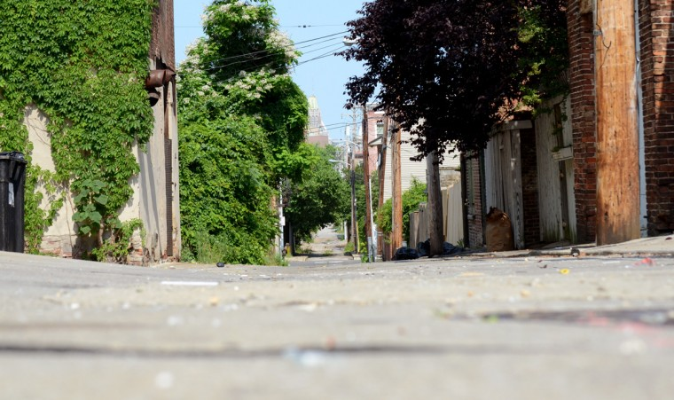 A long alleyway in West Baltimore taken from the ground. (Jon Sham/Patuxent Homestead)
