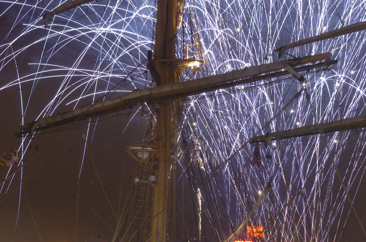 The 2004 4th of July fireworks display is seen through the mast of the Brazilian Navy tallship Cisne Branco at the Inner Harbor. Nikon D2H, ISO 2000, f16 at 8 seconds. (Kenneth K. Lam / The Baltimore Sun)