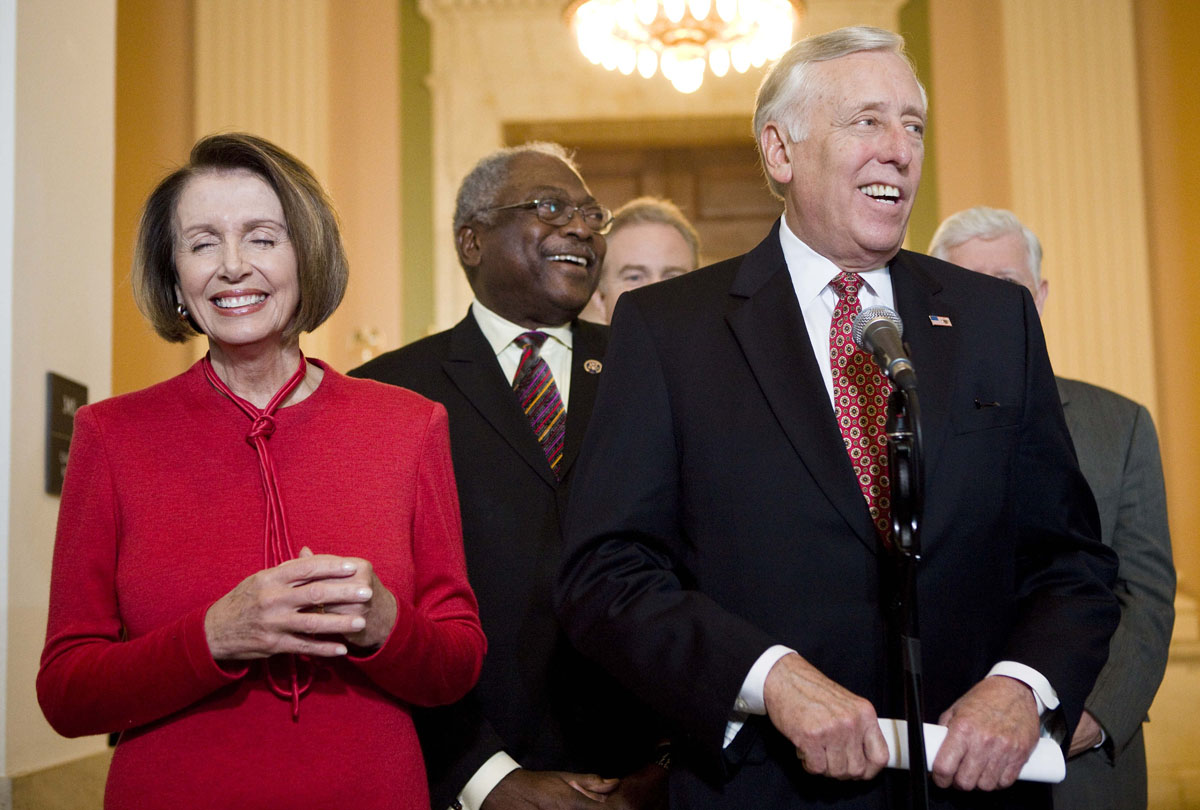 November 7, 2009: Speaker of the House Nancy Pelosi (D-CA) (L), House Majority Whip James Clyburn (D-SC) (C) and House Majority Leader Steny Hoyer (D-MD) (R) laugh while speaking to the press after a caucus meeting with President Barack Obama on Capitol Hill November 7, 2009 in Washington, DC. US President Barack Obama spoke with members of the House Democratic Caucus about healthcare reform legislation which is expected to be voted on today. (Brendan Smialowski/Getty Images)