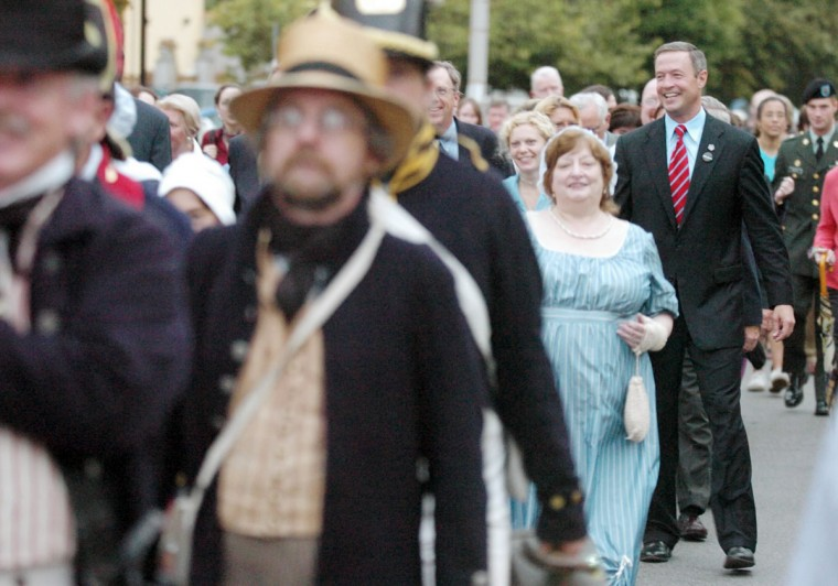 September 7, 2004: ŠThe History Channel's documentary, 'First Invasion: The War of 1812' premiered at the Senator Theater in 2004. Mayor Martin O'Malley (R) marched with reenactors from a reception hosted by the Patriots of Fort McHenry at Ryan's Daughter, to the Senator Theatre for the movie. (Gene Sweeney Jr/ Baltimore Sun)