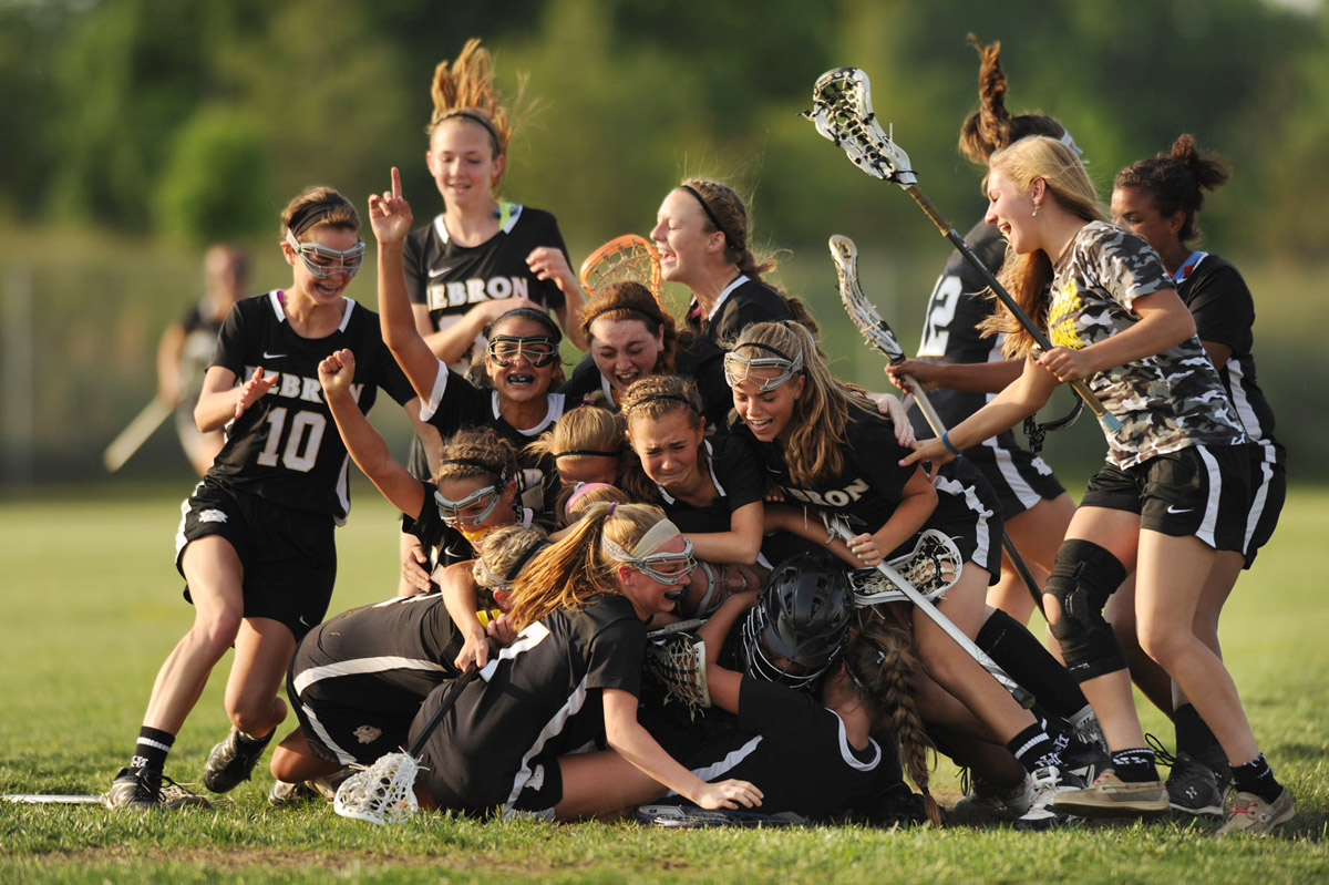 Mt. Hebron teammates celelbrate their victory over Matrriotts Ridge in the girls lacrosse regional championship game at Marriotts Ridge High School in Marriottsville, Md., on Wednesday, May 16, 2012. (Brian Krista/Patuxent Homestead)