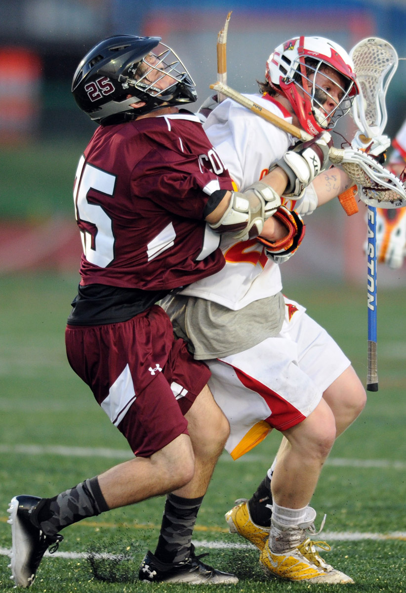 Johnny Kelly of Calvert Hall, right, manages to hold onto the ball as Conestoga's Jared Jacobs breaks his stick on a body check during a boys lacrosse game at Calvert Hall in Baltimore, Md., on Friday, March 23, 2012. (Brian Krista/Patuxent Homestead)