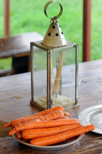 September 9, 2011: Carrots sit near a lantern as re-enactors prepare dinner the way women did around 1812 at Fort McHenry in Baltimore. (Steve Ruark/Baltimore Sun)