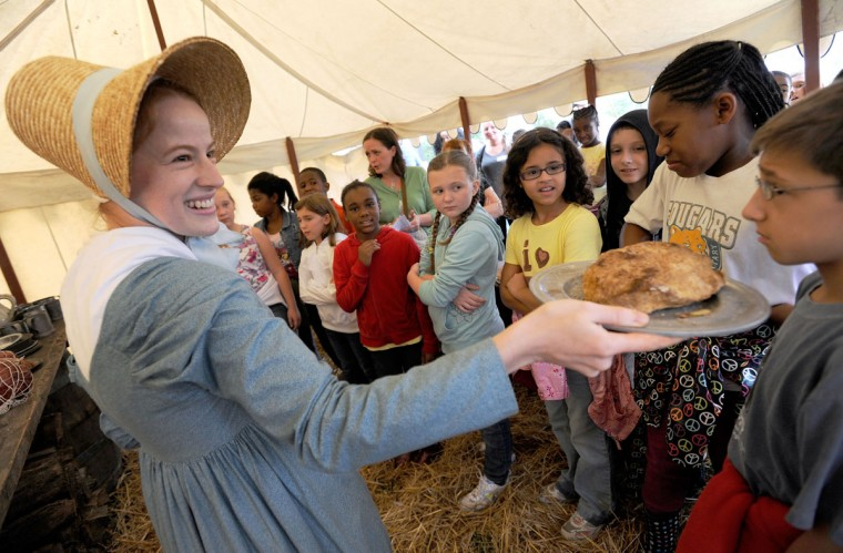 September 9, 2011: Ranger and re-enactor Genna White of Upper Marlboro lets students from Church Creek Middle School smell dried pork like that eaten around 1812 at Fort McHenry in Baltimore. (Steve Ruark/Baltimore Sun)