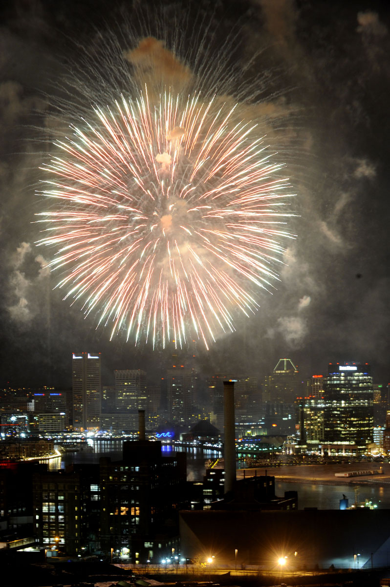 Baltimore rings in 2012 with New Year's Eve fireworks over the inner harbor as seen from Silo Point. Nikon D3, ISO 1000, f7.1 at 1 second. (Kenneth K. Lam / The Baltimore Sun)