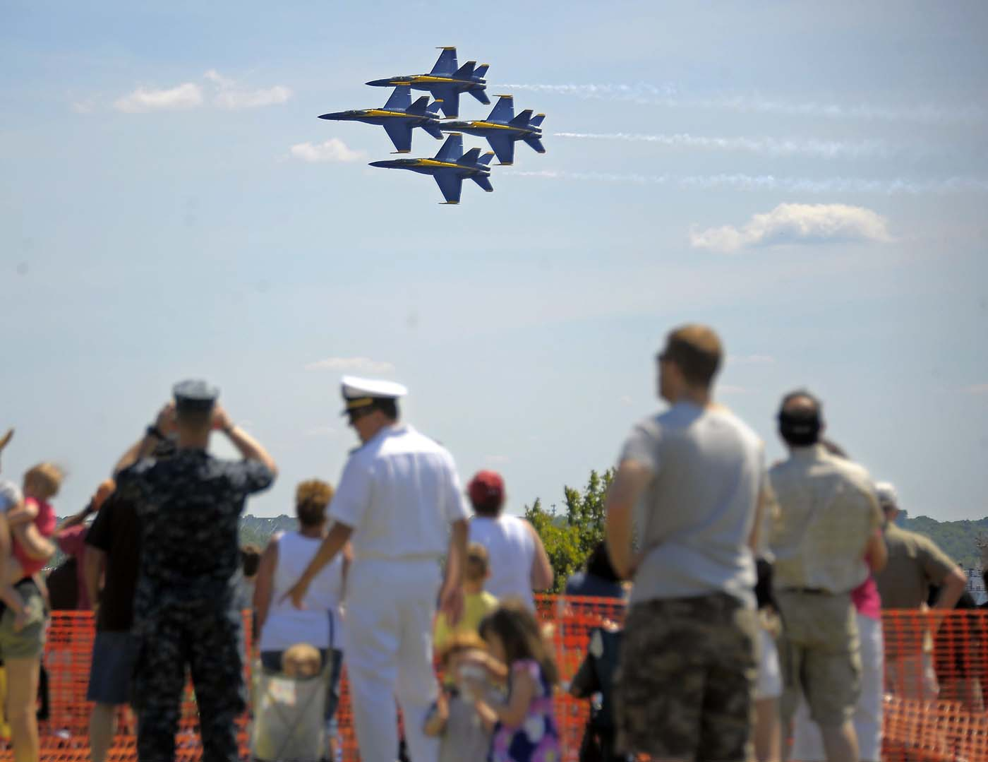 The Blue Angels - Boeing F/A-18 Super Hornet planes - fly in close formation, banking above the sea of spectators who watch the air show during the weekend-long Star Spangled Sailabration 200 at Fort McHenry Saturday, Jun 16, 2012. (Karl Merton Ferron/Baltimore Sun)